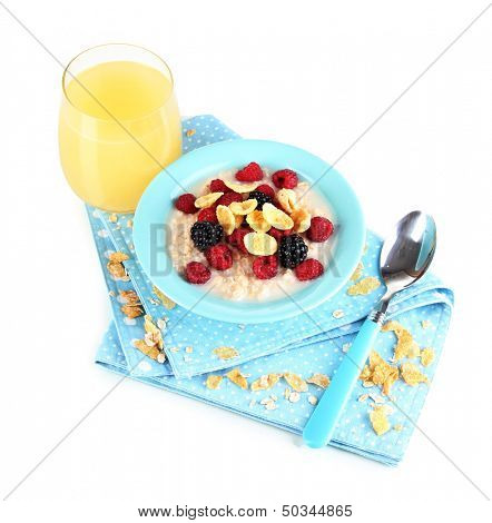 Oatmeal in bowl with berries isolated on white