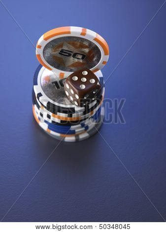 dice and casino chips on the blue background