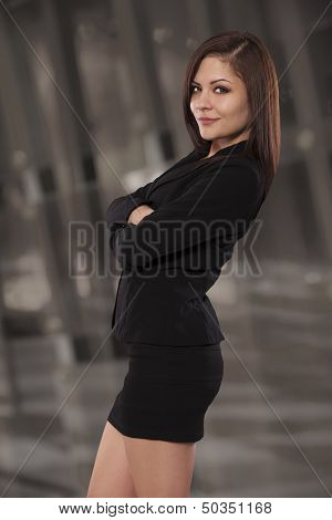 Confident Business Woman Smiles With Her Arms Crossed.