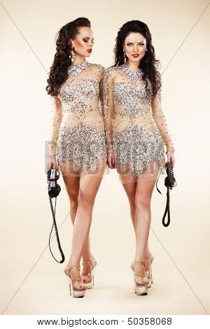 Luxury. Two Trendy Women Walking In Shiny Bright Dresses