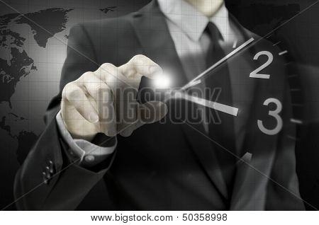 Businessman Navigating Virtual Clock