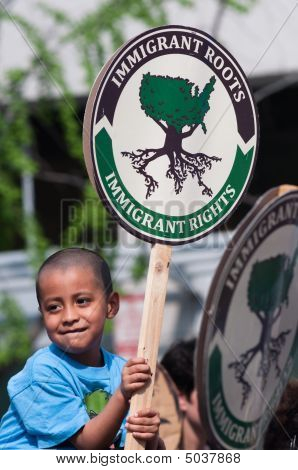 Latino Boy With Sign