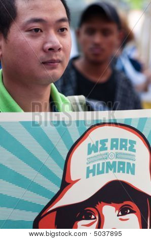 Man With Sign: We Are Human