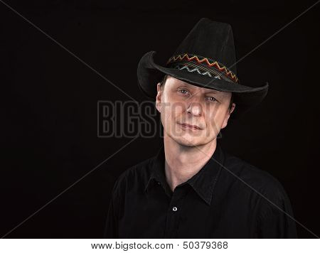 Portrait Of A Man With Cowboy's Hat