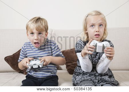 Young brother and sister playing video game