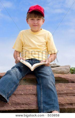Sitting Boy With Book