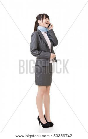 Young asian business woman using cell phone. Full length portrait. Isolated on the white background.