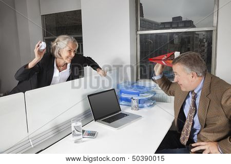 Side view of playful business colleagues in office