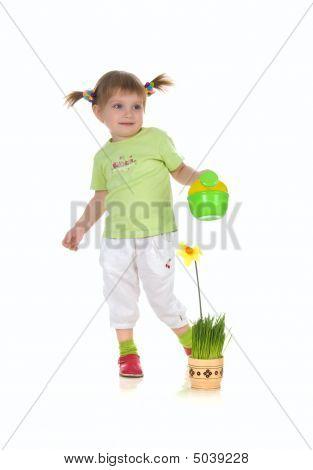 Cute Little Girl Watering The Flower