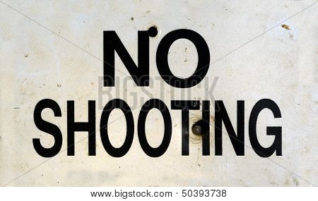 Damaged No Shooting Sign