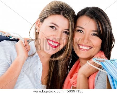 Happy female shoppers smiling - isolated over a white background