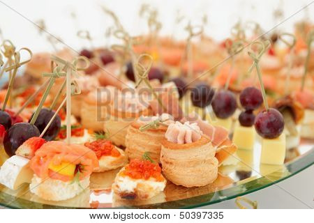 Meat, fish and cheese banquet snacks on banquet platter