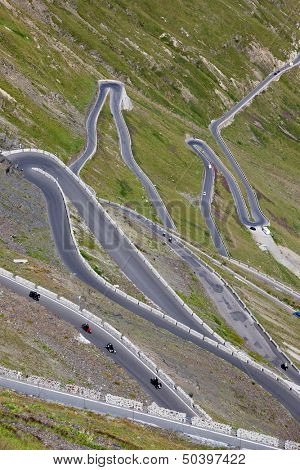 Some of the 48 hairpin turns near the top of the eastern ramp of the Stelvio Pass, South Tyrol, Italy, Europe.
