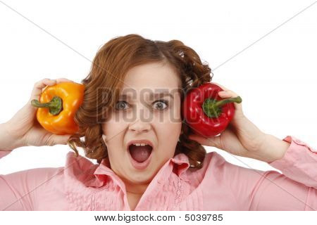 Woman Is Looking Surprised With Sweet Peppers.