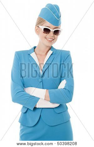 Charming Stewardess Dressed In Blue Uniform And Vintage Sunglasses On White Background