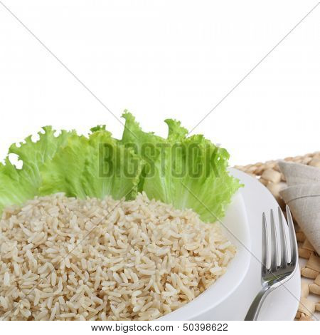 diet dish of boiled wholefood rice with salad isolated on white