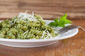 stock photo of pesto sauce  - Fusilli with freshly made pesto genovese and grated parmesan - JPG