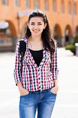 stock photo of knapsack  - Beautiful tourist or student smiling on street - JPG