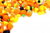 stock photo of sweet-corn  - Halloween corner border of varied candies over white - JPG