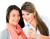 Happy women using app on a mobile phone - isolated over white background