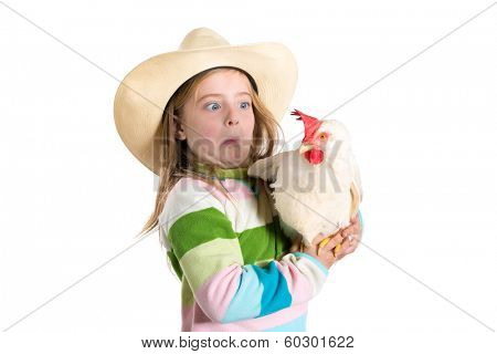 Funny farmer kid girl expression surprised gesture scared about hen on white background