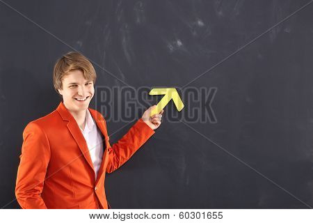 Happy man with a yellow arrow