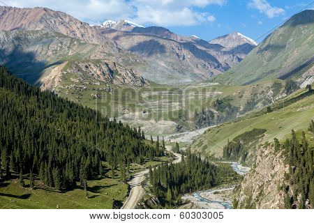 Winding dirt road going to Kumtor gold mine