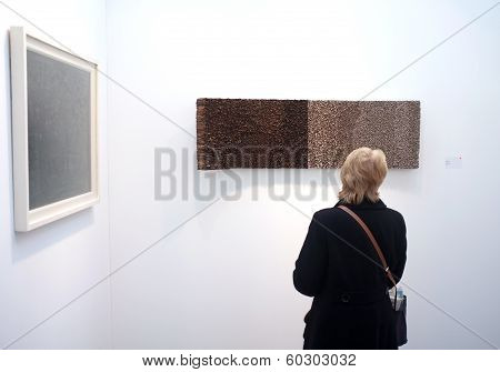 Visitor viewing art