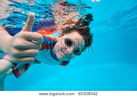 Cute little boy underwater in swimming pool