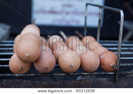Row Of Eggs On Grill, Thailand