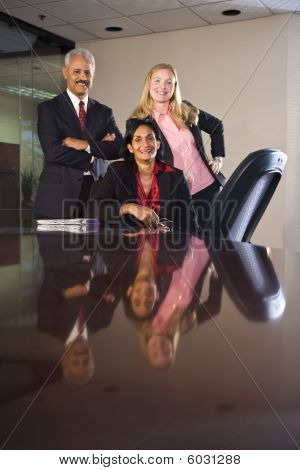 Multi-ethnic businesspeople in boardroom