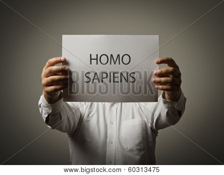 Man Is Holding A Paper Is His Hands. Homo Sapiens.