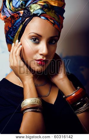 african woman with creative make up, shawl on head like cubian woman