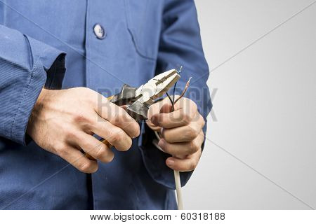 Electrician Repairing An Electrical Cable
