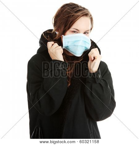 A model wearing a mask to prevent 'Swine Flu' infection. Isolated