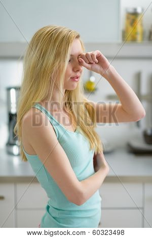 Young Woman Rubbing Eyes After Sleep