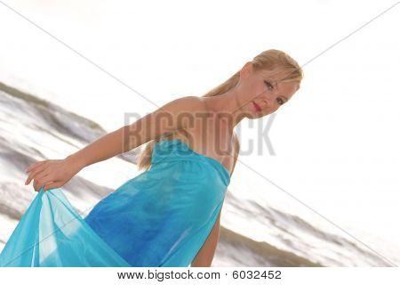 Blonde Woman At Ocean