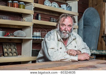 Solemn Western Man At Table