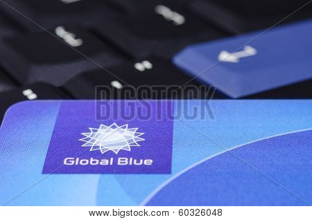 Global Blue Closeup Logo On Plastic Card Against Black Thinkpad Keyboard