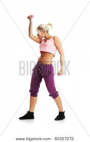 Young beautiful woman during fitness time and exercising with dumb-bell, isolated on white background