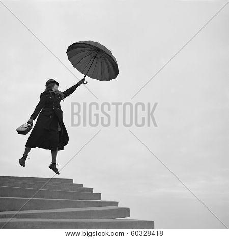 Girl Flying Away On Umbrella