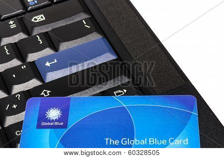 Global Blue Plastic Card On Black Thinkpad Keyboard