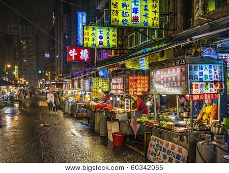 TAIPEI, TAIWAN - JANUARY 12, 2013: Food vendors operate at a night Market on Guangzhou Street. Night markets are a popular part of Taiwanese culture.