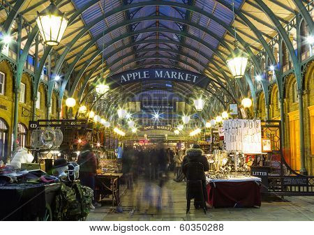 Covent Garden At Night with People Browsing The Stalls