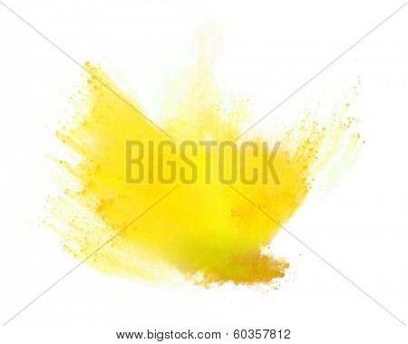 Freeze motion of yellow dust explosion isolated on white background