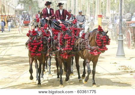 Jerez De La Frontera, Spain-may 11: People Mounted On A Carriage Horse, On Fair Ride On May 11, 2013