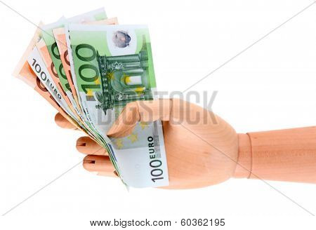 Money in wooden hand, isolated on white