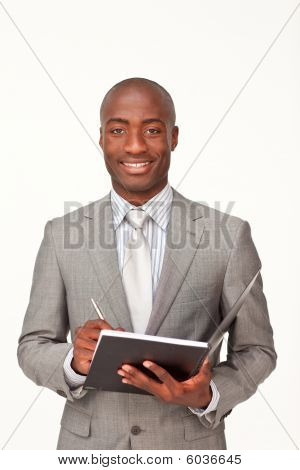 Smiling Afro-american Businessman Writing Notes