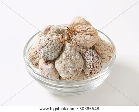 dried figs with sugar served in a glass bowl