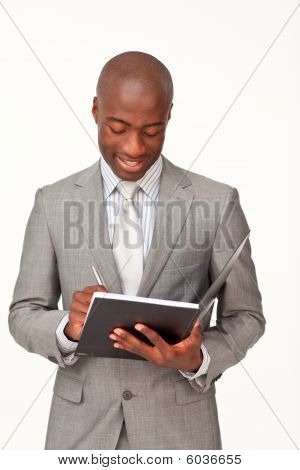 Attractive Businessman Writing Notes